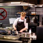 professional chef cooking in commercial kitchen