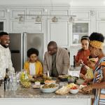 family gathered inside kitchen